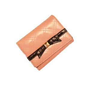 Маленький кошелёк из лакированной кожи персикового цвета с бантиком чёрного цвета