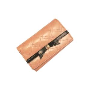 Небольшой нарядный лаковый кошелёк персикового цвета с бантиком чёрного цвета